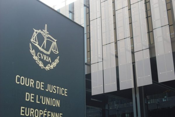 A picture of the sign of the Court of Justice of the EU outside the building in Luxembourg