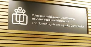 The sign of the Irish Human Rights and Equality Commission against a black background.